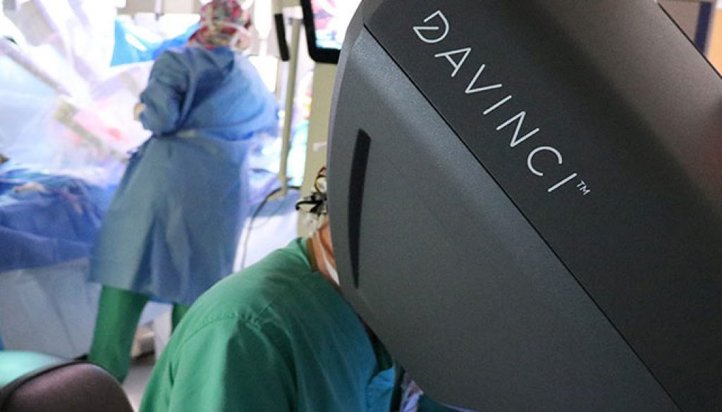 Conway top surgeons performing procedure with robotic equipment.