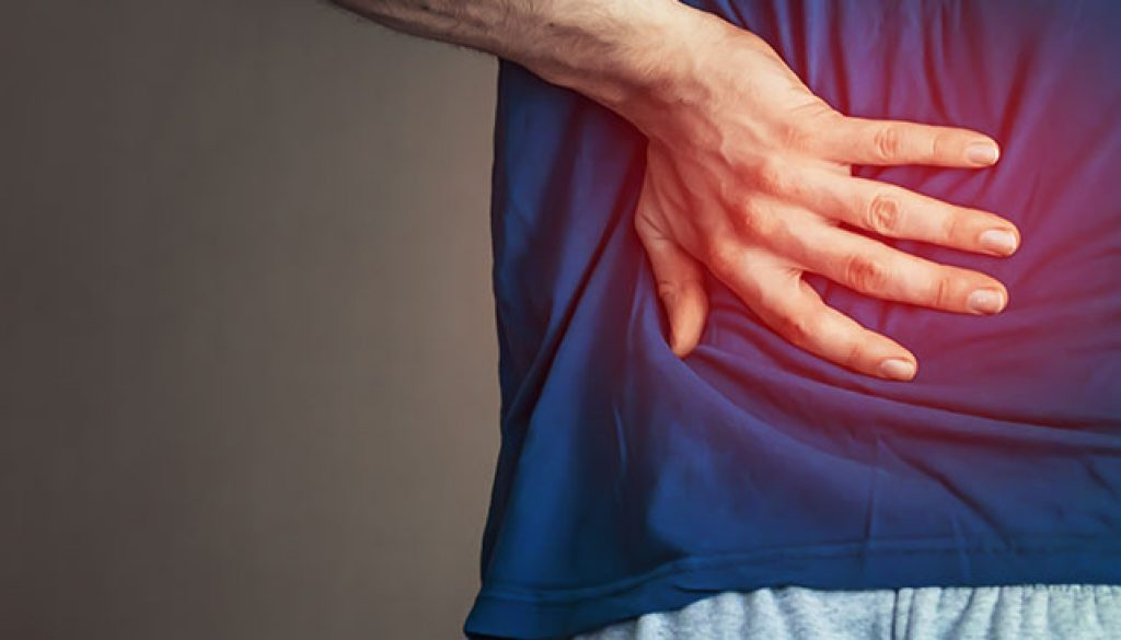 man holding his back due to back pain