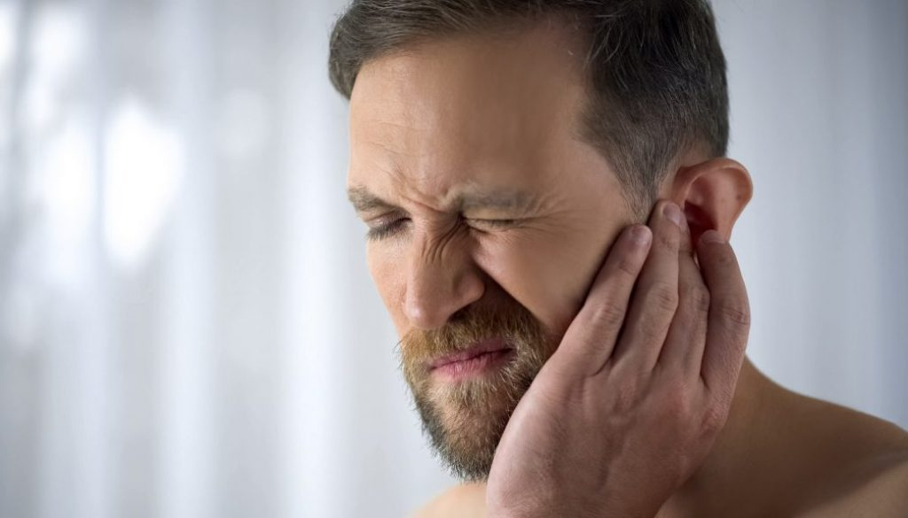 Man Holding His Aching Ear, Suffering From Otitis, Sudden Hearin