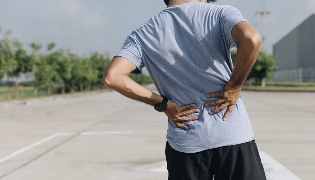 Young Asian Runner Sustains A Back Pain Injury, Sport Injury, Ma